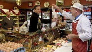 David Cameron buys ten lamb cutlets from butcher Tom Cobb in A Cobb in Aylesbury, Buckinghamshire