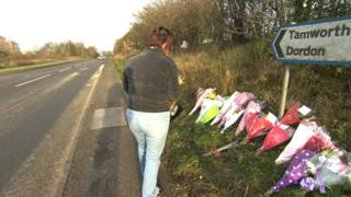 Mourner laying flowers at the scene