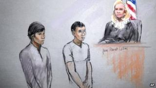 This courtroom sketch signed by artist Jane Flavell Collins shows defendants Dias Kadyrbayev, left, and Azamat Tazhayakov appearing in front of Federal Magistrate Marianne Bowler at the Moakley Federal Courthouse in Boston 1 May 2013