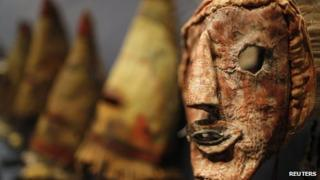 A rare antique tribal mask, Kachina Hapota, circa 1910-1920, is displayed at the Drouot auction house in Paris before auction