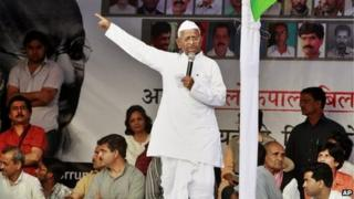 India's anti-corruption activist Anna Hazare gestures as he speaks during his daylong hunger strike at Jantar Mantar in New Delhi, India, Sunday, March 25, 2012