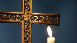 Catholic crucifix and candle