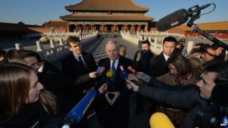 File photo: Foreign media in China interviewing French Prime Minister Jean-Marc Ayrault (C) in Beijing's Forbidden City