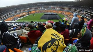 Mourners at a memorial for Nelson Mandela at FNB Stadium (Soccer City) in Johannesburg, South Africa