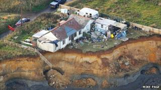 Ms Neirop-Reading's home on the cliff after December tidal surge 2013