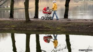 A woman pushing a baby buggy