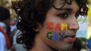 A participant at a gay pride rally in India