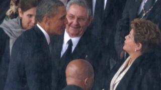 US President Barack Obama greets Cuban President Raul Castro and Brazilian President Dilma Rousseff at Nelson Mandela's memorial service on December 10, 2013.