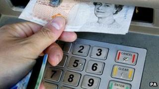 Person withdrawing cash from an ATM (generic)