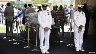 Sailors stand beside the coffin of Nelson Mandela lying in state at the Union Buildings in Pretoria on 11 December 2013