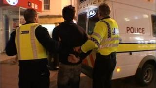 Police arrest a man
