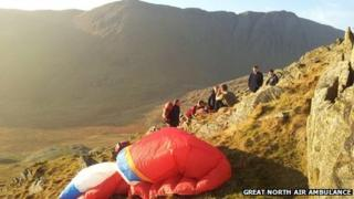 Rescuers help the paraglider