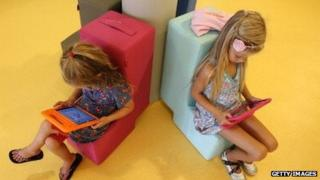 Dutch children look at tablet computers at their school on August 21, 2013.