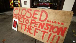 "A sign outside a fire station bearing the words: ""Closed due to pension theft."""