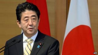 Japanese Prime Minister Shinzo Abe makes a speech in Tokyo, 13 December 2013