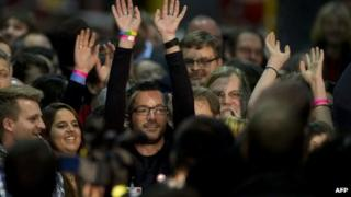 Volunteer SPD vote-counters cheer after results referendum on whether to enter into a grand coalition with its political rivals are announced