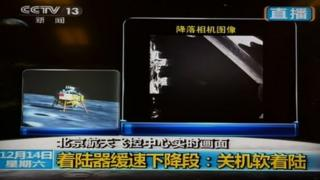 "This screen grab taken from CCTV live broadcasting footage shows an image (R) of China""s first lunar rover transmitted back to the control centre in Beijing after it landed on the moon on December 14, 2013."