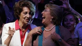 Michelle Bachelet (right) laughs with her mother, Angela Jeria, during a victory rally in Santiago on 15 December, 2013