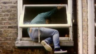 Man breaking into house