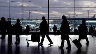 Passengers walking through an airport