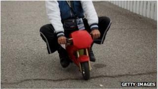 Man riding a mini motorbike