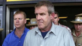 Bradley Murdoch with police at Darwin airport on 24 November 2003