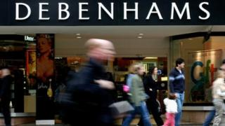 A picture of Debenhams with shoppers outside