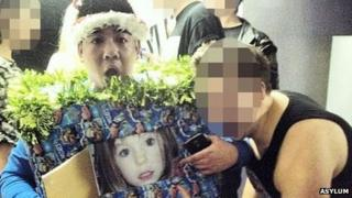 Man in costume depicting photo of Madeleine McCann
