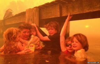 For three hours, Tim Holmes and his family sought refuge in neck-deep water under a jetty near the town of Dunalley.