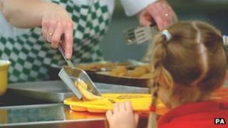 Girl being served school meal