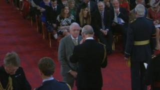 Harry Gration being presented with the MBE at Buckingham Palace