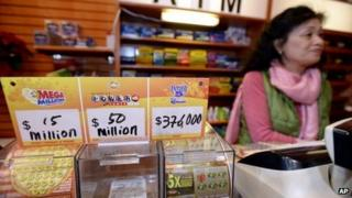 Owner Young Soo Lee tends the counter at her small newsstand on Wednesday, on 18 December 2013 in Atlanta, Georgia