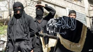 Members of the al-Nusra Front in Aleppo in October 2013