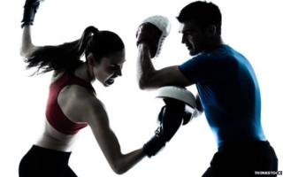 A man and woman boxing