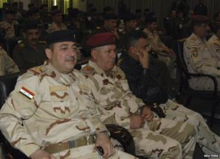 The commander of the Iraqi army's Seventh Division, Maj Gen Mohammed al-Karawi (L), at a conference in Baghdad, 13 December