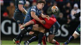 Aled Thomas gets the ball away despite being tackled at Musgrave Park