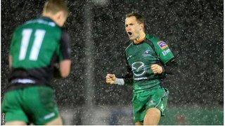 Dan Parks (right) celebrates after landing Connacht's late winning drop goal as snow falls in Galway