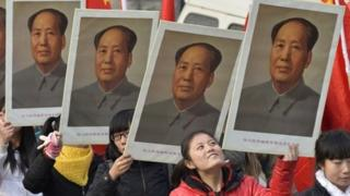 Students hold portraits of China's late Chairman Mao Zedong during a commemorative event ahead of December 26, which marks the 120th anniversary of Mao's birth, at a university campus in Taiyuan, Shanxi province, December 21, 2013.