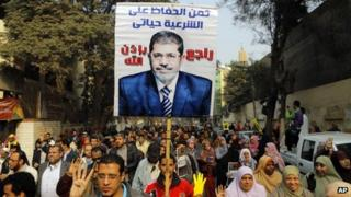 Supporters of Mohammed Morsi at a protest in Cairo on 20 December 2013