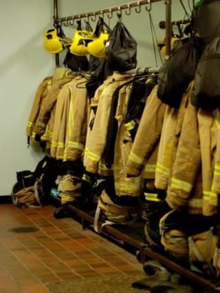 Firefighters uniforms hanging up
