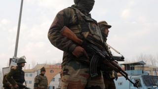 A Kashmiri soldier with a Kalashnikov
