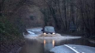 Van on flooded road