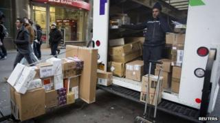 A FedEx delivery man prepares to deliver packages in New York on 24 December