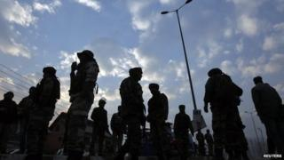 Indian army soldiers stand guard after a shootout in Srinagar December 11, 2013. A Central Reserve Police Force (CRPF) officer was killed and another injured after militants opened fire on a CRPF patrol, police said.