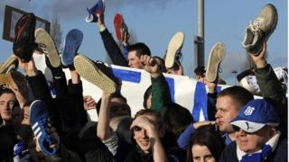Some Cardiff fans held up shoes as part of the protest