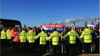 Stewards joined hands to keep the protesters at Cardiff City FC back