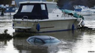 A submerged car next to a boat in East Farleigh, Maidstone, Kent