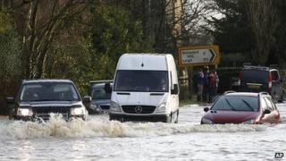 Cars plough through standing water in Reigate, Surrey