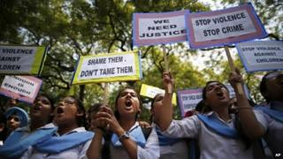 Indian students shout slogans as they hold placards demanding stringent punishment to rapists during a protest in New Delhi, India, Tuesday, April, 23, 2013