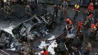 Security forces and firefighters at the scene of car bomb explosion in Beirut which killed Mohamad Chatah (27 December)